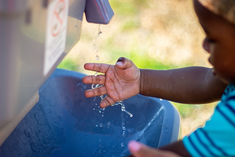 Montessori girl washing her hands and learning about hygiene