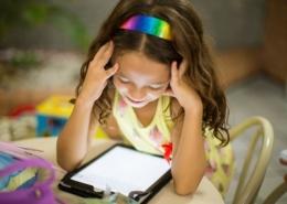Girl staring at a screen